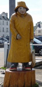 Fisherman sculpture in Stornoway Outer Hebrides by Uisdean Paterson